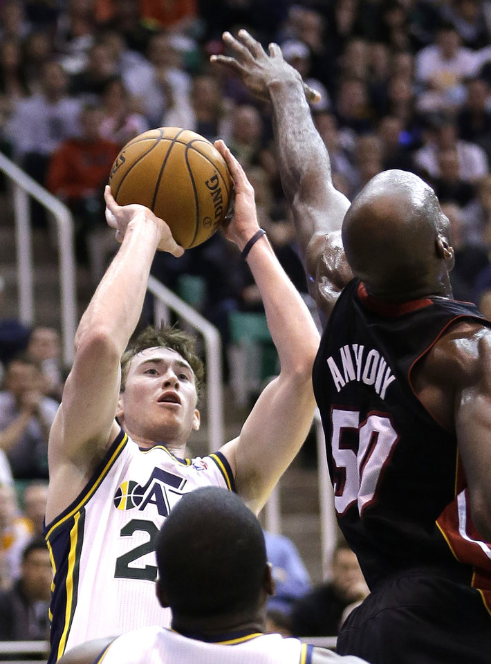 Utah Jazz guard Gordon Hayward (20) shoots as Miami Heat center Joel Anthony (50) defends in the fourth quarter during an NBA basketball game Monday, Jan. 14, 2013, in Salt Lake City. The Jazz defeated the Heat 104-97.  (AP Photo/Rick Bowmer)