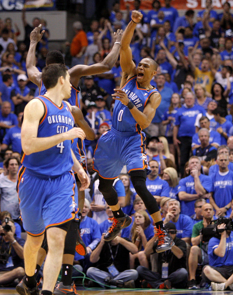 Photo - Oklahoma City's Russell Westbrook (0) celebrates beside James Harden and Nick Collison during Game 4 of the first round in the NBA playoffs between the Oklahoma City Thunder and the Dallas Mavericks at American Airlines Center in Dallas, Saturday, May 5, 2012. Oklahoma City won 103-97. Photo by Bryan Terry, The Oklahoman