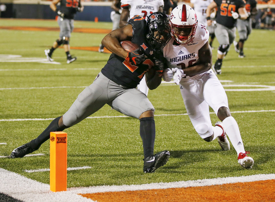 Photo - Oklahoma State's J.D. King (27) collides with South Alabama's Spencer Perry (26) as he scores a touchdown in the fourth quarter during a college football game between Oklahoma State (OSU) and South Alabama at Boone Pickens Stadium in Stillwater, Okla., Saturday, Sept. 8, 2018. Photo by Nate Billings, The Oklahoman