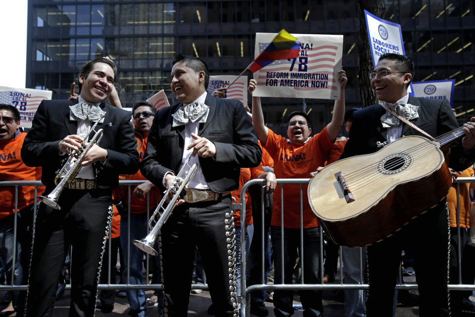 Participants shout at a rally outside the office of Sen. Chuck Schumer, D-N.Y., in New York, Wednesday, April 10, 2013. Over one hundred people, including a Mariachi band, gathered to express their support for immigration reform and to thank Schumer for his leadership on the issue. Organizers say thousands of immigrants and activists will take part in rallies in at least 18 states as part of a nationwide week of action, asking Congress to approve immigration reforms to grant 11 million immigrants living illegally in the United States a pathway toward citizenship. (AP Photo/Seth Wenig)