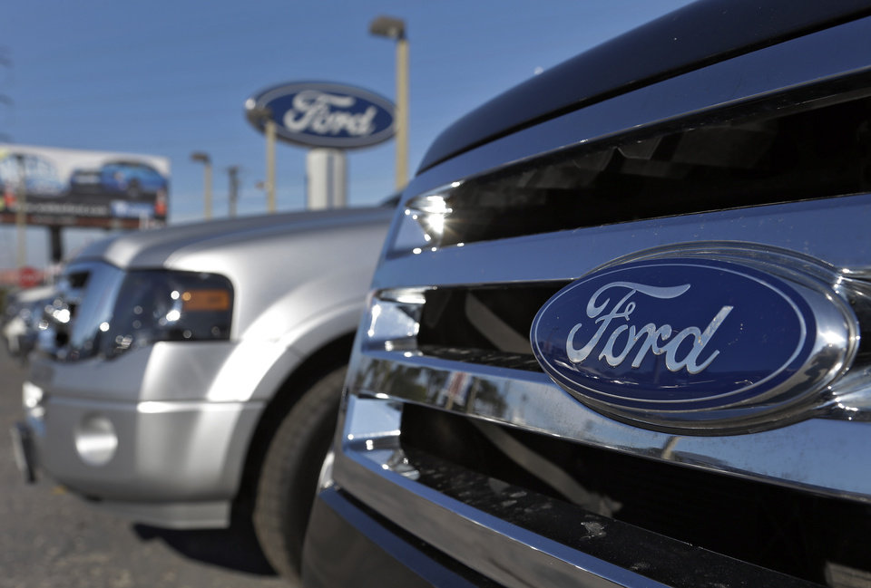 In this Monday, Nov. 19, 2012, photo, the front grill of a new Ford Explorer is seen at a dealership, in Clearwater, Fla. GE announced Tuesday, Nov. 20, 2012, that it is buying 2,000 plug-in hybrid cars from Ford for its corporate fleet. (AP Photo/Chris O\'Meara)