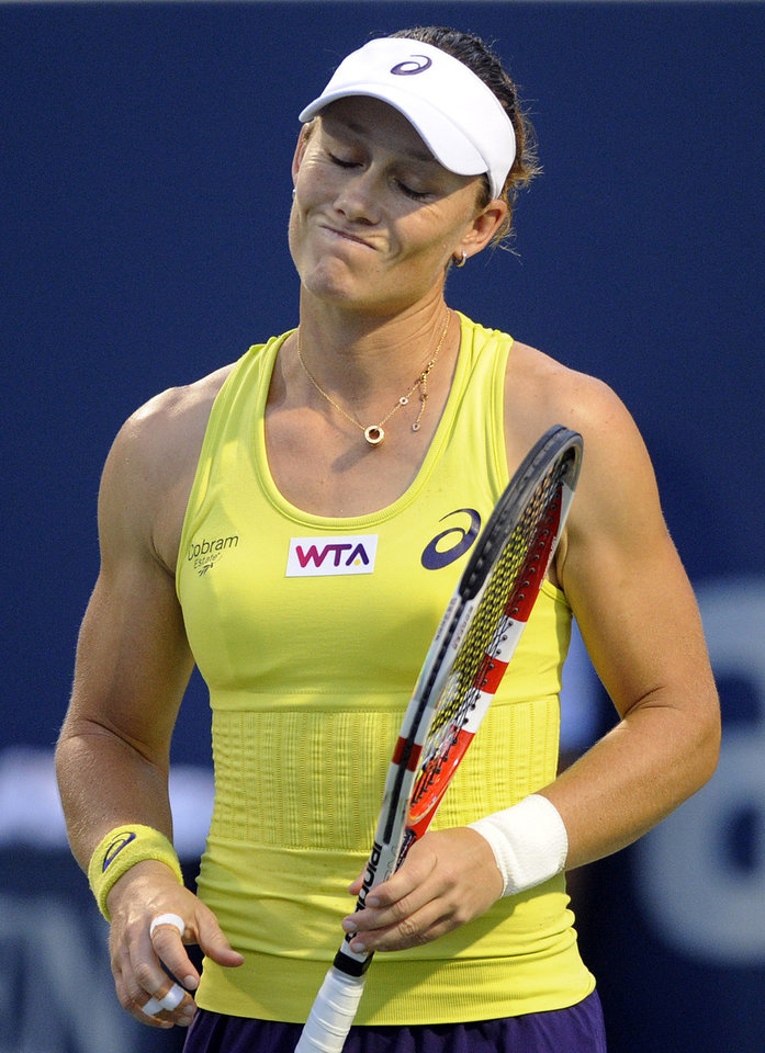 Photo - Samantha Stosur, of Australia, reacts during a semifinal against Petra Kvitova, of the Czech Republic, at the New Haven Open tennis tournament in New Haven, Conn., on Friday, Aug. 22, 2014. (AP Photo/Fred Beckham)
