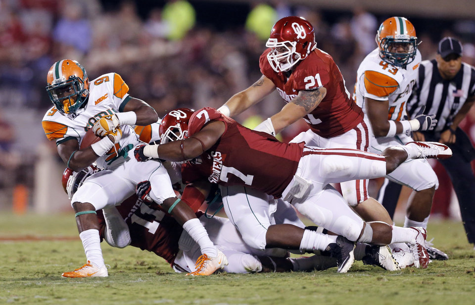 Photo - Sooner Corey Nelson (7) stops Eddie Rocker (9) during the second half of the college football game between the University of Oklahoma Sooners (OU) and Florida A&M Rattlers at Gaylord Family—Oklahoma Memorial Stadium in Norman, Okla., Saturday, Sept. 8, 2012. Photo by Steve Sisney, The Oklahoman