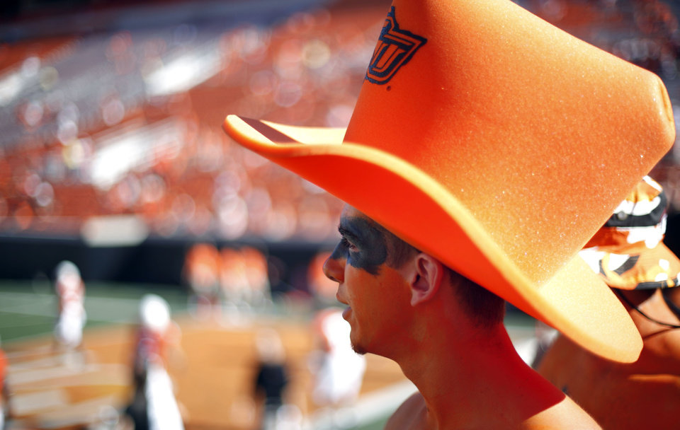 Photo - Oklahoma State fan Matt Tucker watches the Cowboys warm up before the college football game between the Washington State Cougars (WSU) and the Oklahoma State Cowboys (OSU) at Boone Pickens Stadium in Stillwater, Okla., Saturday, September 4, 2010. Photo by Sarah Phipps, The Oklahoman