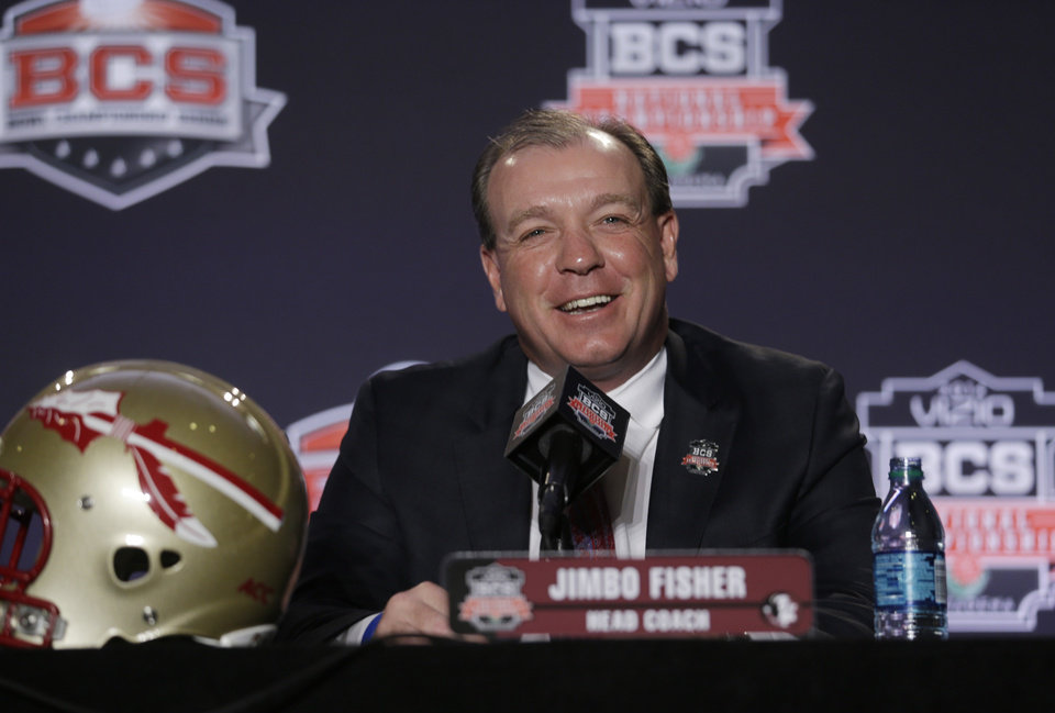 Photo - Florida State head coach Jimbo Fisher answers a question during a news conference for the NCAA BCS National Championship college football game Sunday, Jan. 5, 2014, in Newport Beach, Calif. Florida State plays Auburn on Monday, Jan. 6, 2014. (AP Photo/Morry Gash)