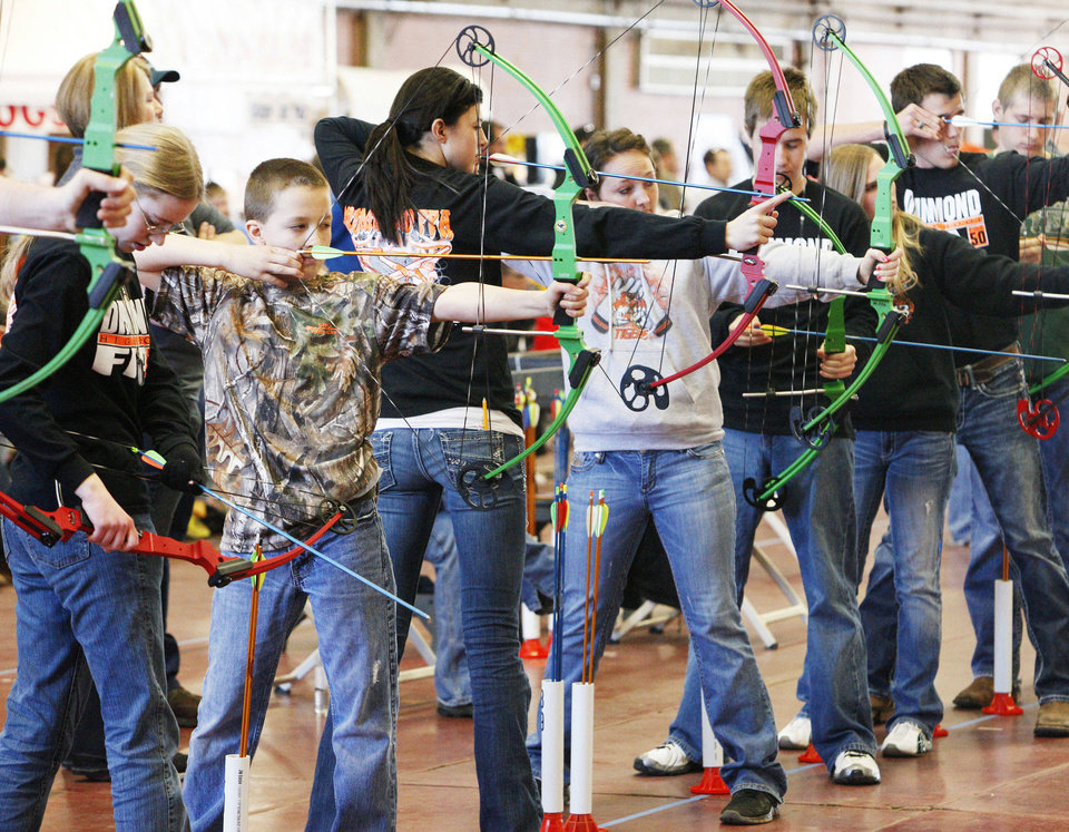 Students compete in last month's regional archery shoot. The state Archery in the Schools tournament will be Wednesday beginning at 9 a.m. in the Travel and Transportation Building on the state fairgrounds. <strong>PAUL B. SOUTHERLAND</strong>