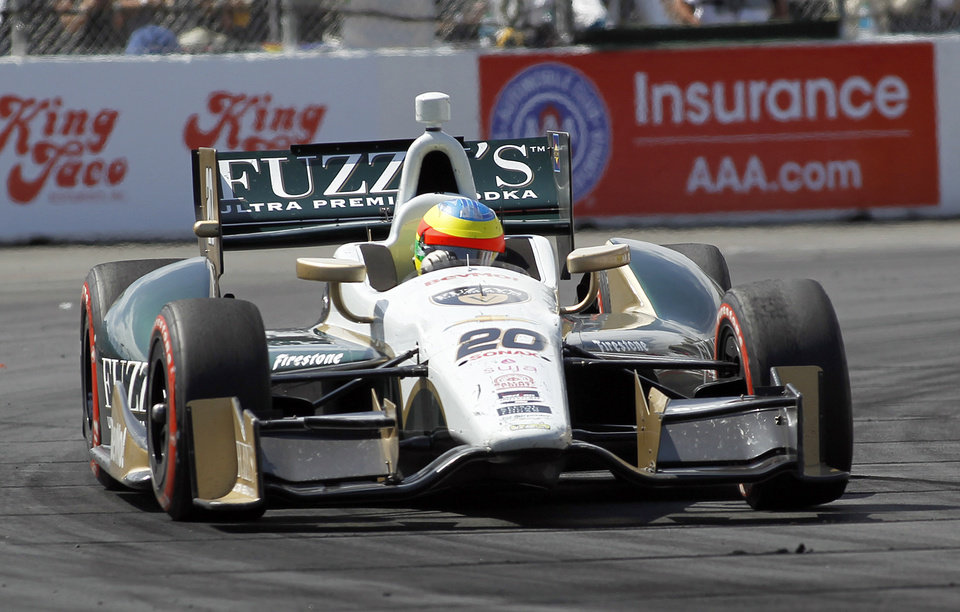 Photo - Mike Conway, of England, drives through a turn en route to winning the IndyCar Grand Prix of Long Beach auto race, Sunday, April 13, 2014, in Long Beach, Calif. (AP Photo/Alex Gallardo)