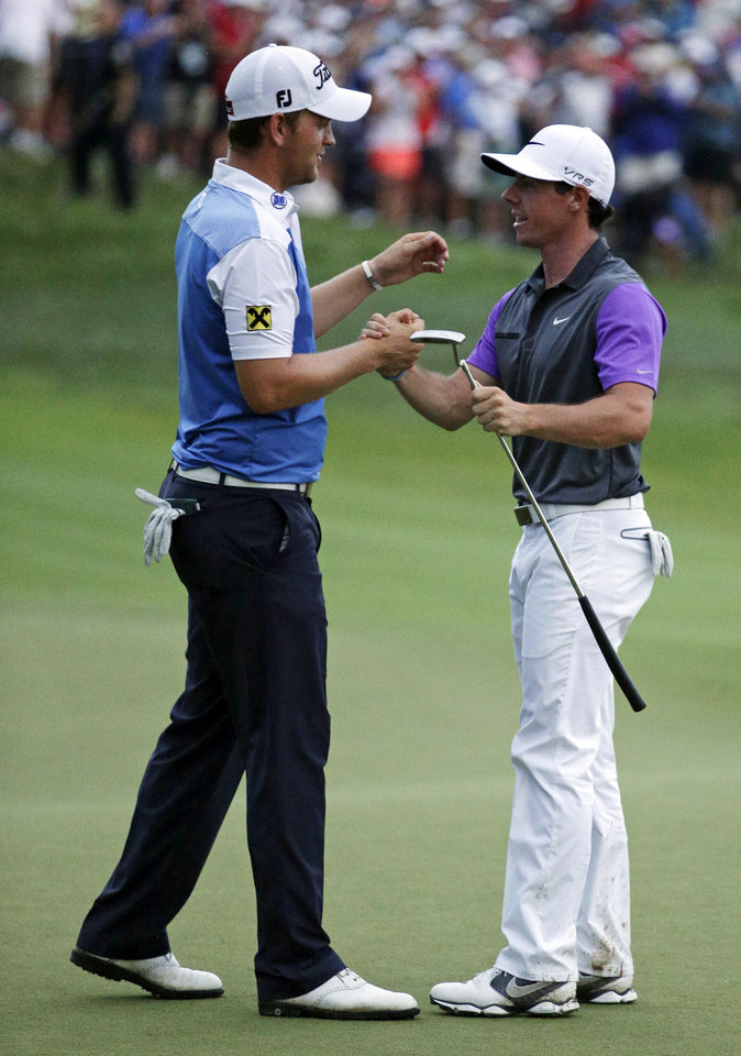 Photo - Rory McIlroy, of Northern Ireland, right, greets Bernd Wiesberger, of Austria, after winning the PGA Championship golf tournament at Valhalla Golf Club on Sunday, Aug. 10, 2014, in Louisville, Ky. (AP Photo/John Locher)