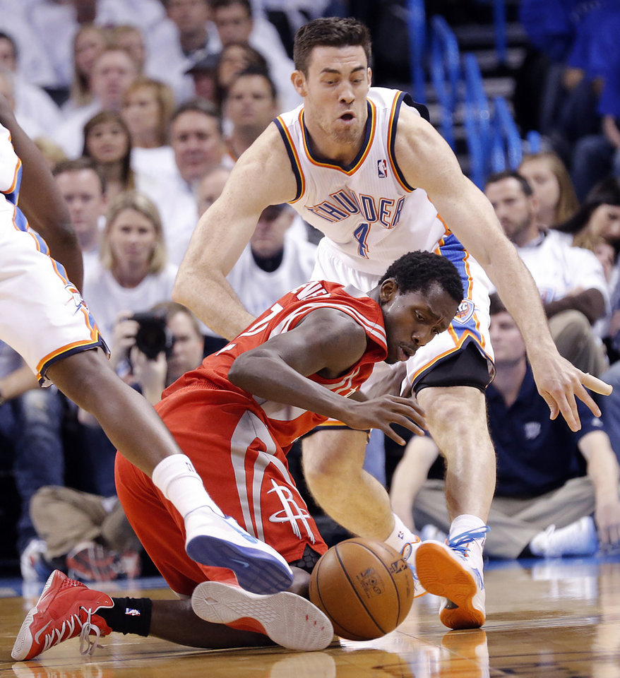 Oklahoma City's Nick Collison (4) and Houston's Patrick Beverley (12) battle for a loose ball during Game 2 in the first round of the NBA playoffs between the Oklahoma City Thunder and the Houston Rockets at Chesapeake Energy Arena in Oklahoma City, Wednesday, April 24, 2013. Photo by Chris Landsberger, The Oklahoman