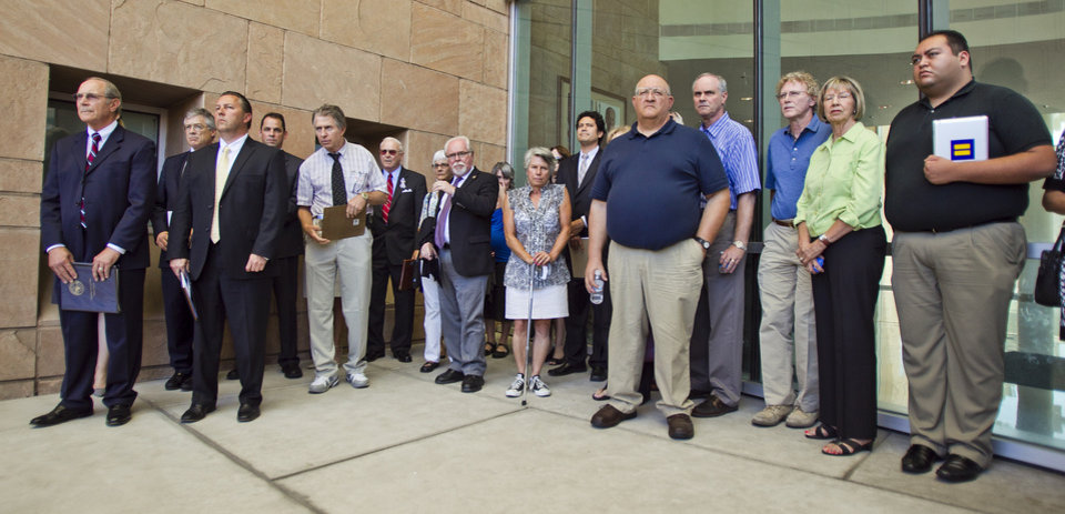 Photo -   U.S. Rep. Ron Barber, center left, and Daniel Hernandez, former staff intern for former U.S. Rep. Gabrielle Giffords, right, join attorneys, investigators, and victims of the 2011 Tucson shootings for a news conference outside U. S. District Court in Tucson, Ariz. Tuesday, Aug. 7, 2012, where Jared Lee Loughner appeared for a plea hearing. Loughner agreed to spend the rest of his life in prison, accepting that he went on a deadly shooting rampage at an Arizona political gathering and avoiding the prospect of a trial that might have brought him the death penalty. (AP Photo/The Arizona Republic, Tom Tingle) MARICOPA COUNTY OUT; MAGS OUT; NO SALES