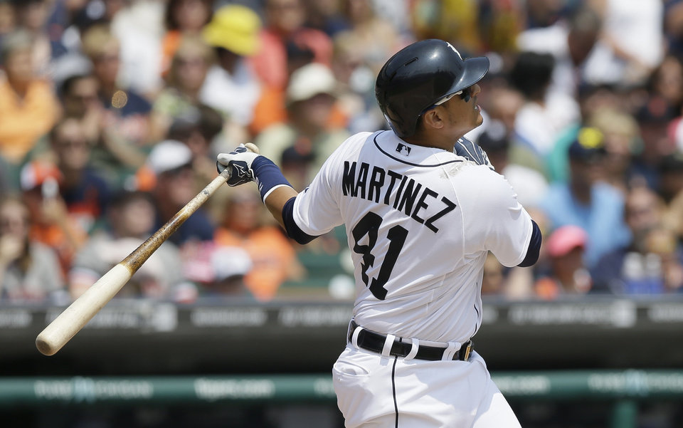 Photo - Detroit Tigers designated hitter Victor Martinez watches the flight of his three-run home run during the third inning of an interleague baseball game against the Colorado Rockies, Sunday, Aug. 3, 2014, in Detroit. (AP Photo/Carlos Osorio)