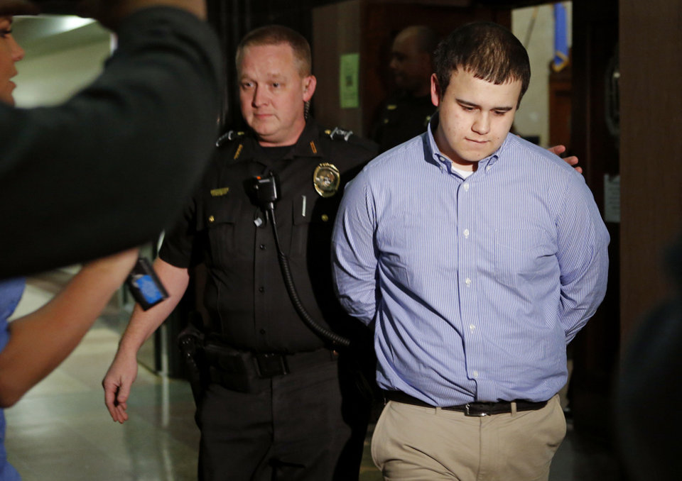 Photo - Tristan Owen, 17,  leaves the courtroom after being found guilty of two counts of manslaughter and one count of arson in an Oklahoma City, Friday, Feb. 22, 2013. Photo by Bryan Terry, The Oklahoman