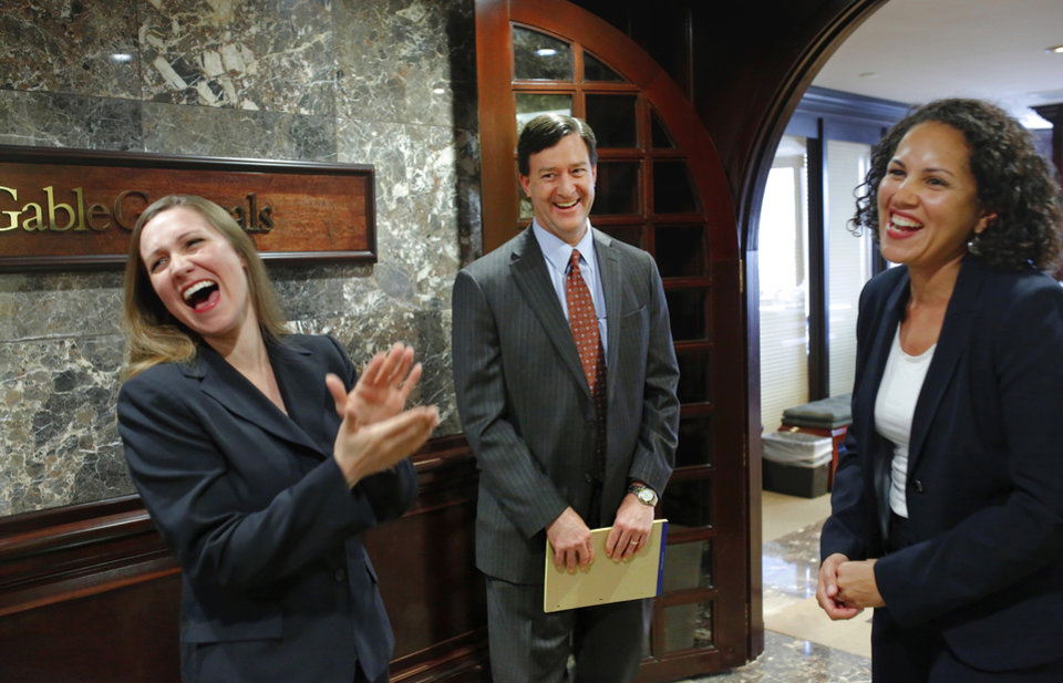 Photo -  Dave Keglovits, chief executive of GableGotwals, shares a laugh with attorneys Ellen Adams, left, and Diana Vermeire in the law firm's downtown Oklahoma City offices. Photo by Jim Beckel, The Oklahoman   Jim Beckel -  THE OKLAHOMAN