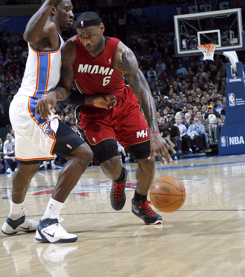 Photo - Oklahoma City's Jeff Green tries pressures Miami's LeBron James during their NBA basketball game at the OKC Arena in Oklahoma City on Thursday, Jan. 30, 2011. Photo by John Clanton, The Oklahoman