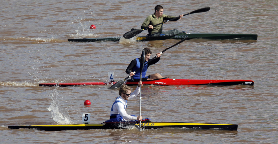From the top down, Zac Robertson, Austin Schwinn and Cedric Bond compete in a men's kayak 200m semifinal during the USA Canoe/Kayak U.S. Olympic Team Trials on the Oklahoma River in Oklahoma City, Friday, April 20, 2012. Bond finished first. Schwinn finished third. Robertson came in fifth. Photo by Nate Billings, The Oklahoman