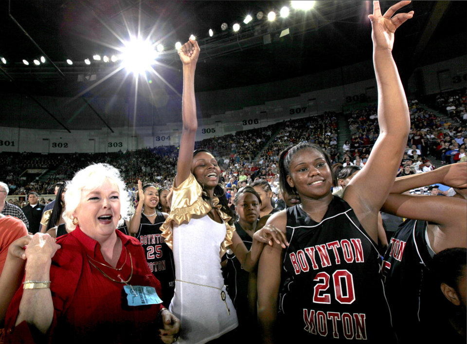 Photo - Boynton-Moton' s coach Shartese McHenry, middle, and Shawanda Lang celebrate their win over Cyril in the final of the Class B girls basketball state tournament  at the State Fair Arena, Saturday, March 6, 2010, in Oklahoma City. Photo by Sarah Phipps, The Oklahoman