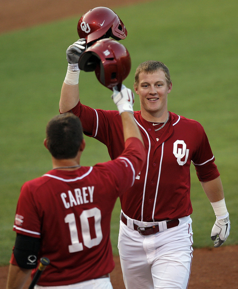 Oklahoma's Matt Oberste (14) celebrates his home run with Garrett Carey (10) during the Bedlam baseball game between The University of Oklahoma and Oklahoma State University at  Oklahoma City, Saturday, May 5, 2012. Photo by Sarah Phipps, The Oklahoman