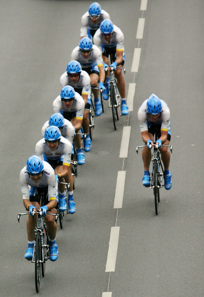 Photo - FILE - In this July 5, 2005, file photo, Lance Armstrong, right, lets his Discovery Channel teammates take over after taking the lead during the fourth stage of the Tour de France cycling race, a 67.5-kilometer (41.95-mile) team time trial between Tours and Blois, western France. After a decade of denial and being stripped of his titles, Armstrong has finally come clean_ During an interview with Oprah Winfrey taped Monday, Jan. 14, 2013, Armstrong said he used performance-enhancing drugs to win the Tour de France, a person familiar with the situation told The Associated Press. (AP Photo/Christophe Ena, File)