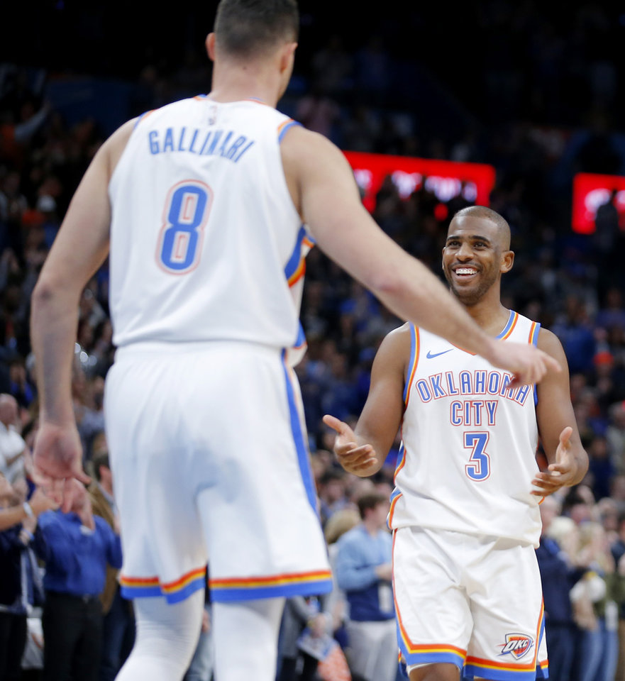 Photo - Oklahoma City's Chris Paul (3) smiles as he walks to Danilo Gallinari (8) after a steal in the final minute of an NBA basketball game between the Oklahoma City Thunder and the Dallas Mavericks at Chesapeake Energy Arena in Oklahoma City, Tuesday, Dec. 31, 2019. Oklahoma City won 106-101. [Bryan Terry/The Oklahoman]