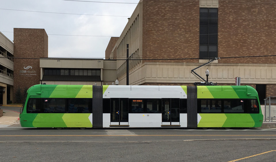 Photo - The modern Liberty streetcars manufactured in western Pennsylvania are numbered 201801 through 201807. They go into revenue service on Friday after several months of tests and operator training. This streetcar was pulling away from a boarding platform near St. Anthony Hospital. [The Oklahoman Archive]