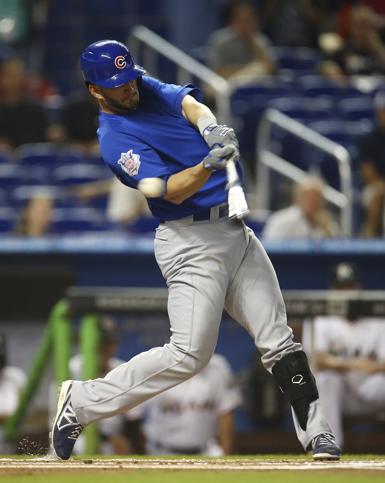 Photo - Chicago Cubs batter Justin Ruggiano strikes a pitch by Miami Marlins' Tom Koehler during the first inning of a baseball game in Miami, Monday, June 16, 2014. (AP Photo/J Pat Carter)