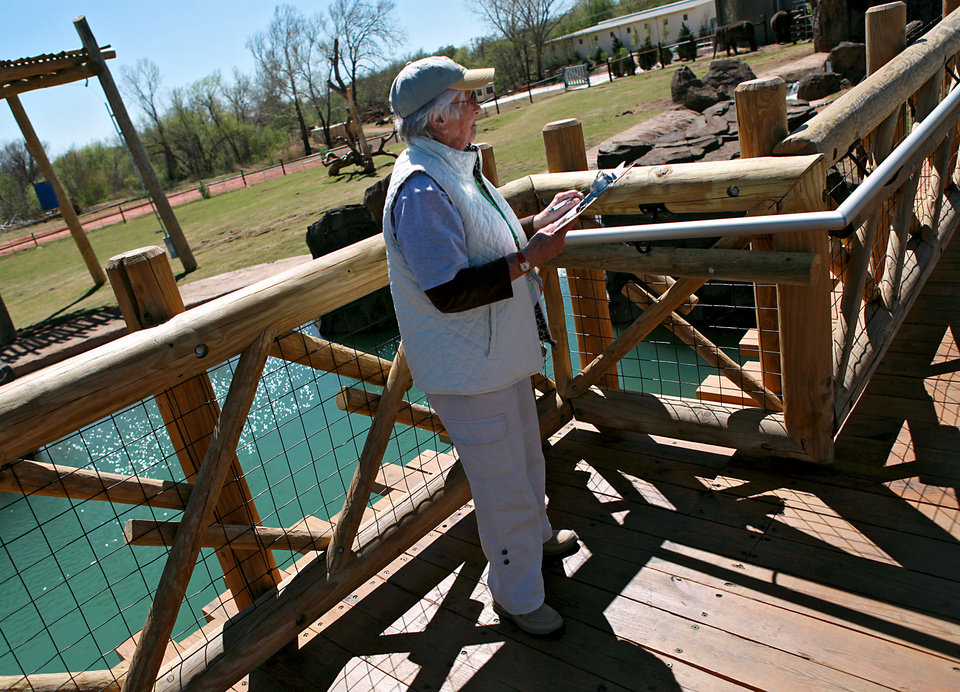 Volunteer Nancy Adams watches Asha and keeps notes on her progress at the new Elephant Exhibit on Tuesday, April 5, 2011. Volunteers and staff are keeping a 24-hour watch on Asha as her due date gets closer. Photo by John Clanton, The Oklahoman