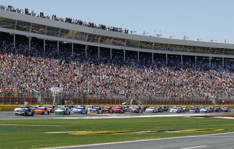 Photo - The field takes the green flag to start the NASCAR Nationwide series History 300 auto race at Charlotte Motor Speedway in Concord, N.C., Saturday, May 24, 2014. (AP Photo/Terry Renna)
