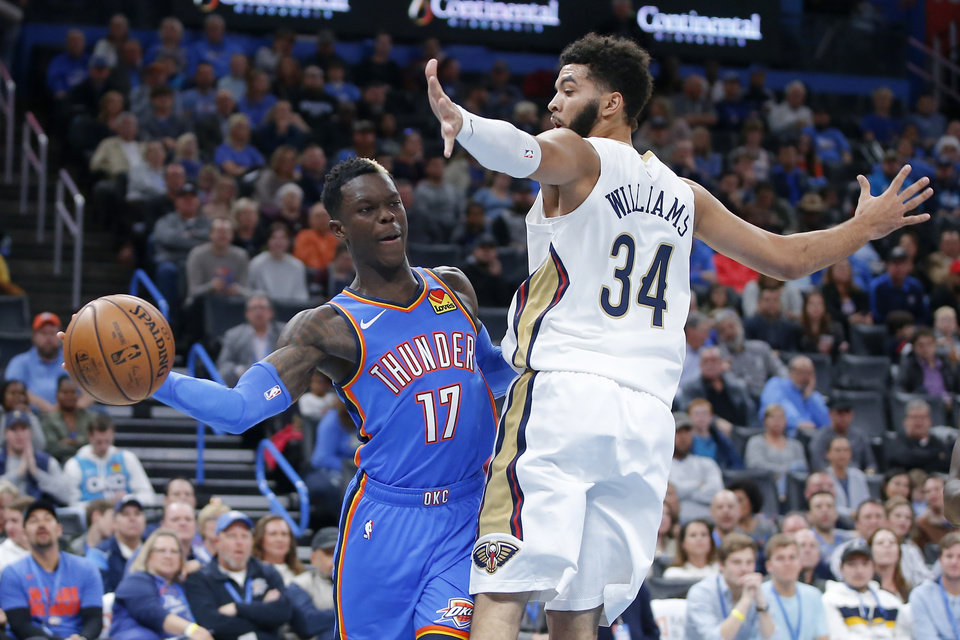 Photo - Oklahoma City's Dennis Schroder (17) passes the ball as New Orleans' Kenrich Williams (34) defends during an NBA basketball game between the Oklahoma City Thunder and the New Orleans Pelicans at Chesapeake Energy Arena in Oklahoma City, Saturday, Nov. 2, 2019. Oklahoma City won 115-104. [Bryan Terry/The Oklahoman]