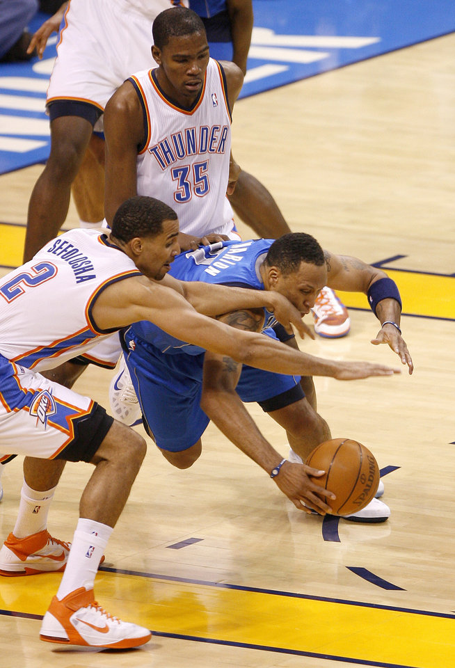Oklahoma City's Thabo Sefolosha (2) and Kevin Durant (35) defend Shawn Marion (0) of Dallas  during game 4 of the Western Conference Finals in the NBA basketball playoffs between the Dallas Mavericks and the Oklahoma City Thunder at the Oklahoma City Arena in downtown Oklahoma City, Monday, May 23, 2011. Photo by Bryan Terry, The Oklahoman