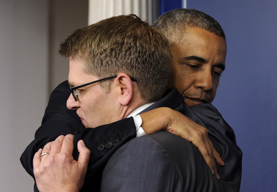 Photo - President Barack Obama gives White House press secretary Jay Carney a hug after announcing that Carney will step down later next month, during a surprise visit to the Brady Press Briefing Room of the White House, Friday, May 30, 2014. The president announced Carney's departure in a surprise appearance at in the White House press briefing room Friday. He said principal deputy press secretary Josh Earnest will take over the job. (AP Photo/Susan Walsh)