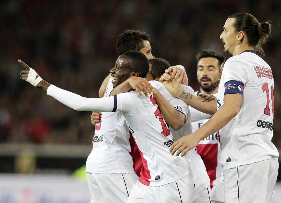 Photo - PSG's players celebrate the third goal scored,  during their French League one soccer match against Lille at the Lille Metropole stadium, in Villeneuve d'Ascq, northern France, Saturday, May 10, 2014. Paris Saint-Germain have  won their second straight French league title. (AP Photo/Michel Spingler)