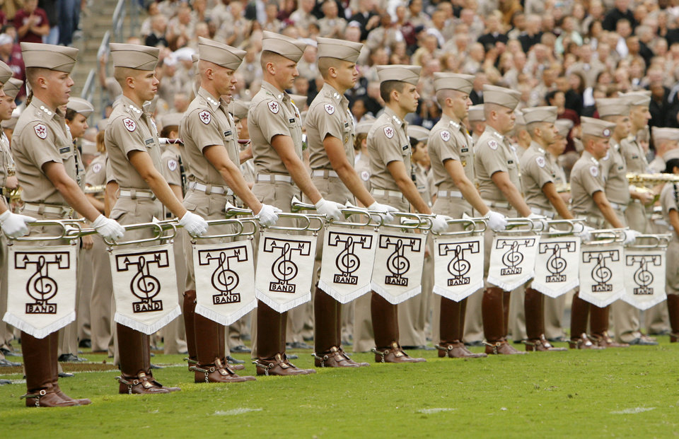 Photo - Members of the Texas A&M Fighting Aggie Band line up to perform at halftime during the college football game between Oklahoma State University (OSU) and Texas A&M University at Kyle Field in College Station, Texas, Saturday, October 10, 2009. Photo by Nate Billings, The Oklahoman ORG XMIT: KOD