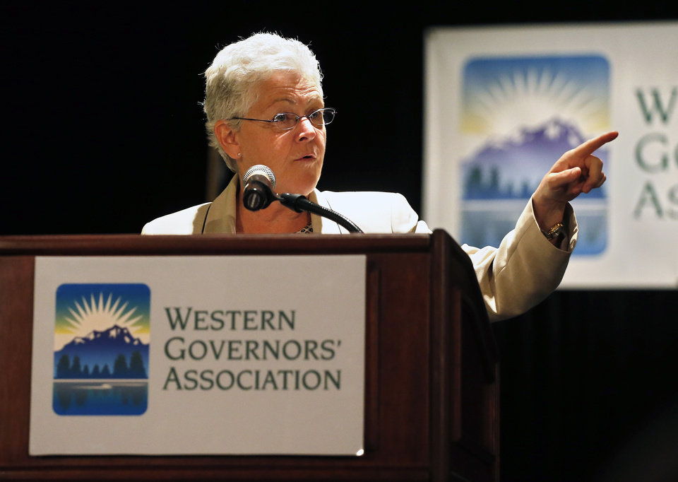 Photo - EPA Administrator Gina McCarthy delivers a keynote speech during the annual Western Governors' Association Meeting, at the Broadmoor Hotel in Colorado Springs, Tuesday, June 10, 2014. The head of the Environmental Protection Agency promoted currently proposed clean power plant rules to Western governors Tuesday, framing the plan as a way to deal with destructive wildfires and floods that have ravaged the region in recent years. (AP Photo/Brennan Linsley)