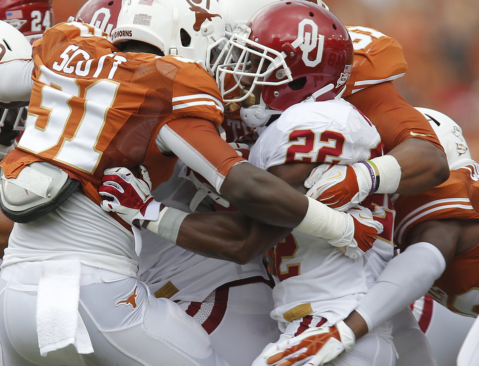 The Texas defense stops OU's Roy Finch (22) during the Red River Rivalry college football game between the University of Oklahoma Sooners (OU) and the University of Texas Longhorns (UT) at the Cotton Bowl Stadium in Dallas, Saturday, Oct. 12, 2013. Photo by Chris Landsberger, The Oklahoman