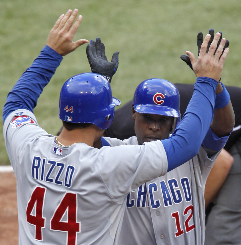 Photo -   Chicago Cubs' Alfonso Soriano (12) and Anthony Rizzo (44) celebrate after Soriano drove in them both with a two-run home run in the eighth inning of the baseball game against the Pittsburgh Pirates, Sunday, Sept. 9, 2012, in Pittsburgh. The Cubs won 4-2, sweeping the Pirates in a three-game series. (AP Photo/Keith Srakocic)