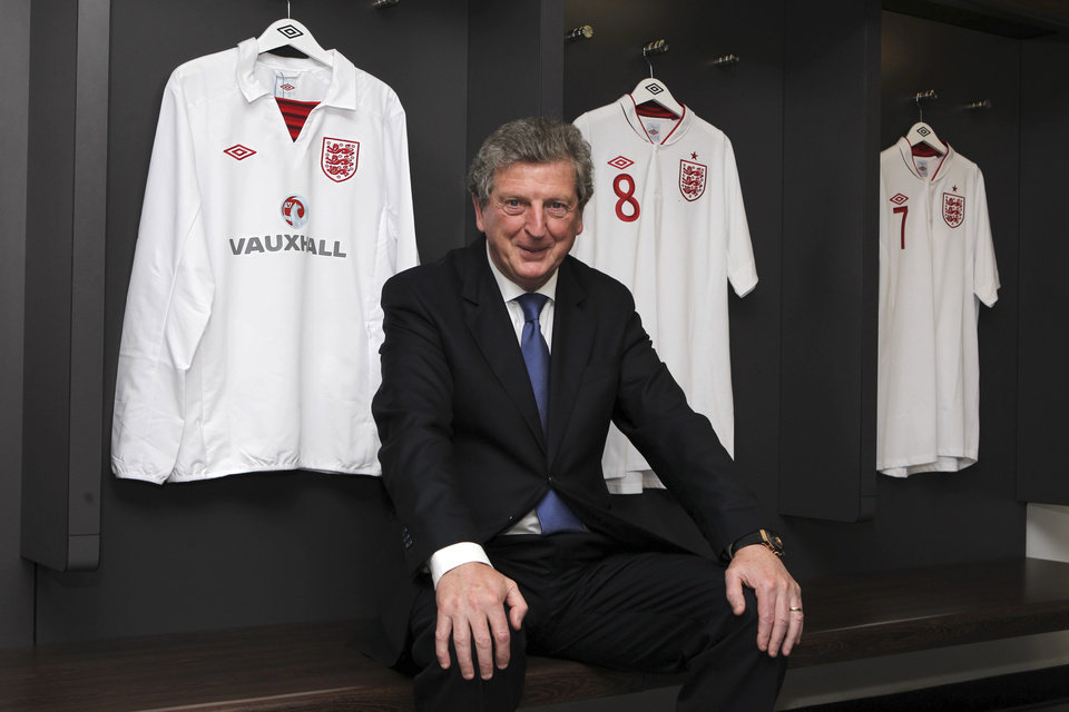 Newly appointed England soccer manager Roy Hodgson smiles in the dressing room at Wembley Stadium in London Tuesday May 1, 2012. Hodgson was appointed England manager on a four-year contract on Tuesday, ending months of speculation over who would lead the national team to next month's European Championship. . (AP Photo/Andy Couldridge, Pool)