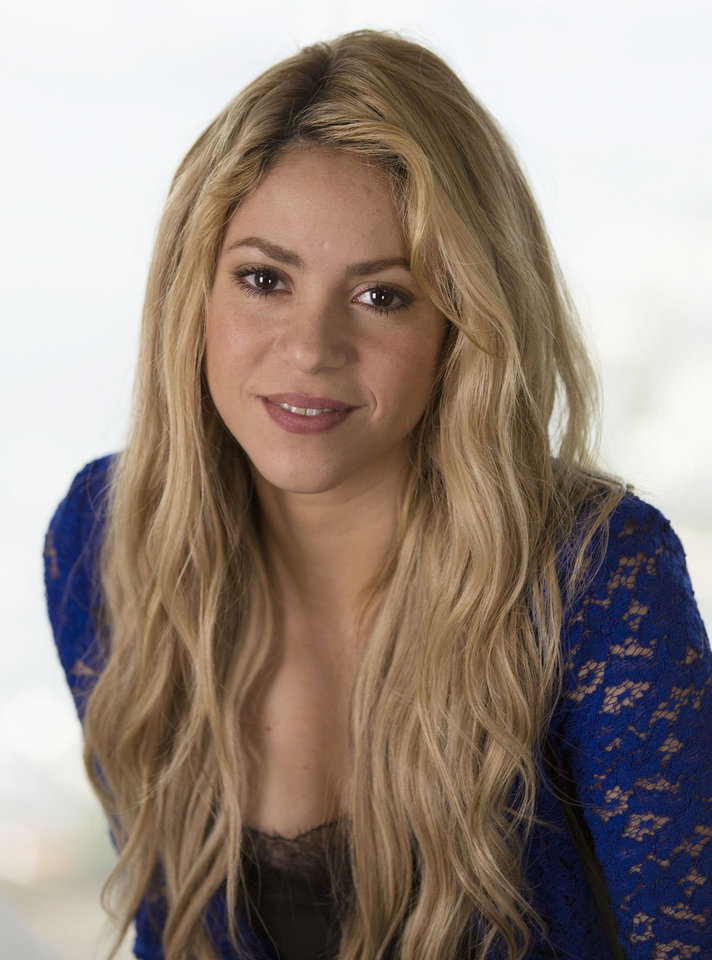 Photo - Colombian pop star singer Shakira poses for a photo during an interview in Rio de Janeiro, Brazil, Saturday, July 12, 2014. Shakira will perform at the World Cup's closing ceremony at Maracana Stadium, Sunday. (AP Photo/Leo Correa)