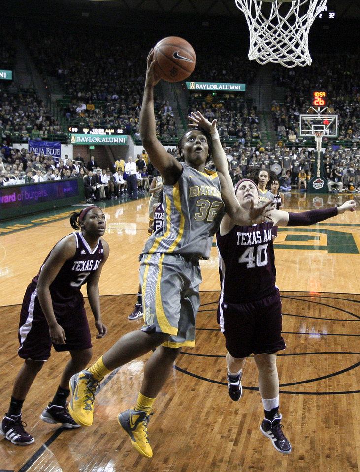 Baylor\'s Brooklyn Pope (32) goes up for a shot as Texas A&M\'s Kelsey Assarian (40) defends in the second half of an NCAA college basketball game Saturday, Feb. 11, 2012, in Waco, Texas. Baylor won 71-48. (AP Photo/Tony Gutierrez)