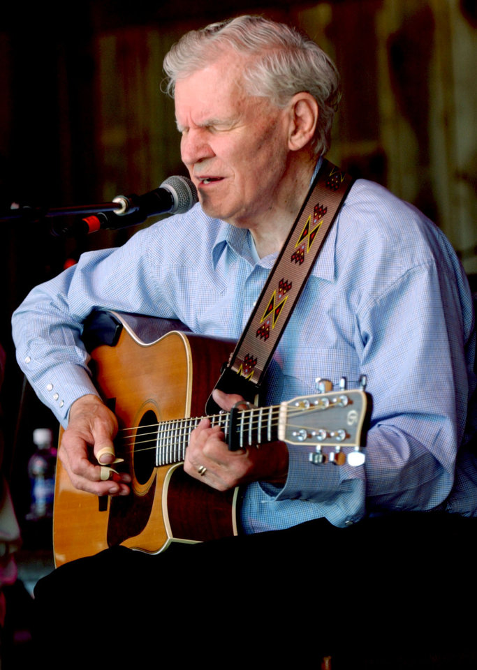"FILE - In this May 1, 2005 file photo, master flatpicker Doc Watson plays during the ""My Friend Merle"" show during MerleFest in Wilkesboro, N.C. Watson, the Grammy-award winning folk musician whose lightning-fast style of flatpicking influenced guitarists around the world for more than a half-century, died Tuesday, May 29, 2012 at a hospital in Winston-Salem, according to a hospital spokeswoman and his management company. He was 89. (AP Photo/The Winston-Salem Journal, Lauren Carroll)"