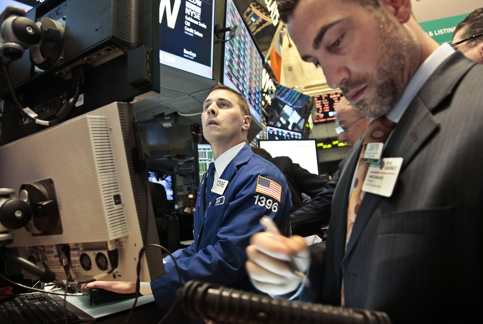 Photo -   Joseph Mastrolia, left, a trader with Barclays, and Chris Casaliggi, Euronext floor manager, begin early trading on the floor of the New York Stock Exchange on Tuesday, Nov. 20, 2012. (AP Photo/Bebeto Matthews)