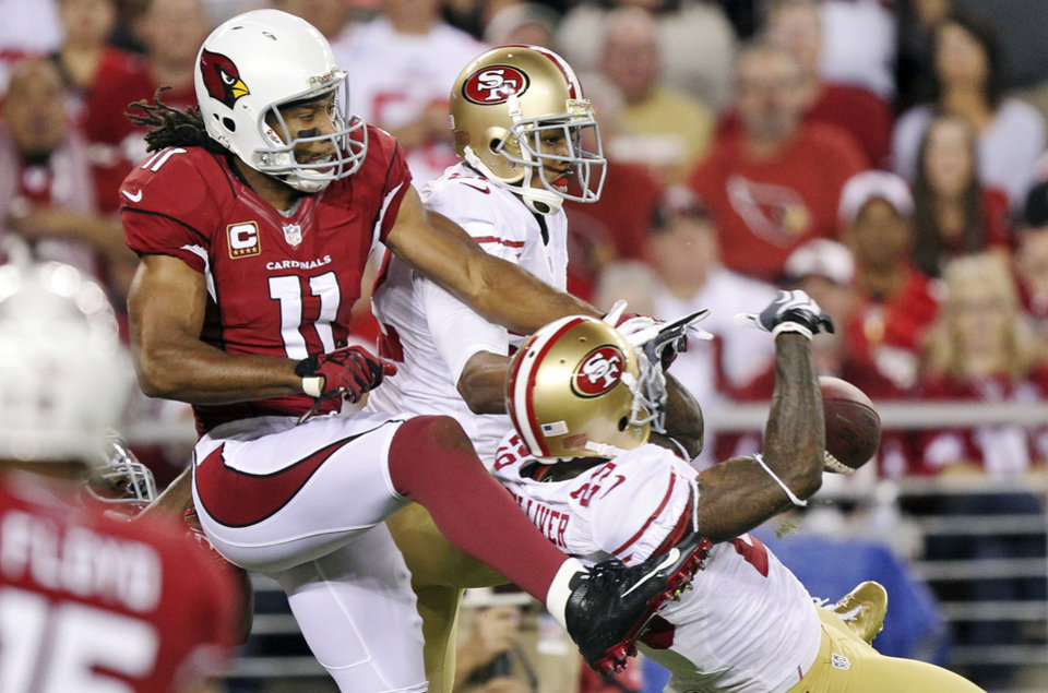Photo -   San Francisco 49ers defensive back Chris Culliver (29) and Carlos Rogers break up a pass intended for Arizona Cardinals wide receiver Larry Fitzgerald (11) during the first half of an NFL football game, Monday, Oct. 29, 2012, in Glendale, Ariz. (AP Photo/Paul Connors)