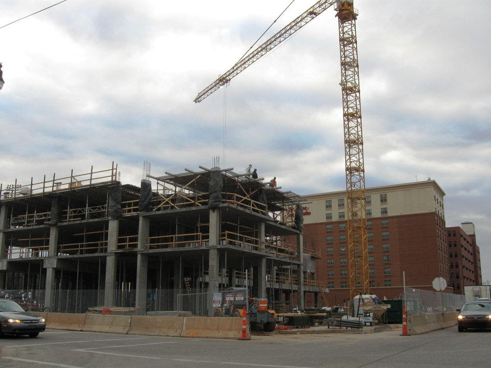 Construction continues Friday on the 11-story Hilton Garden Inn/Homeward Suites at 328 E Sheridan Ave. The hotel is one of two being built in or around Bricktown, with five others to be built over the next two years. <strong> - STEVE LACKMEYER</strong>