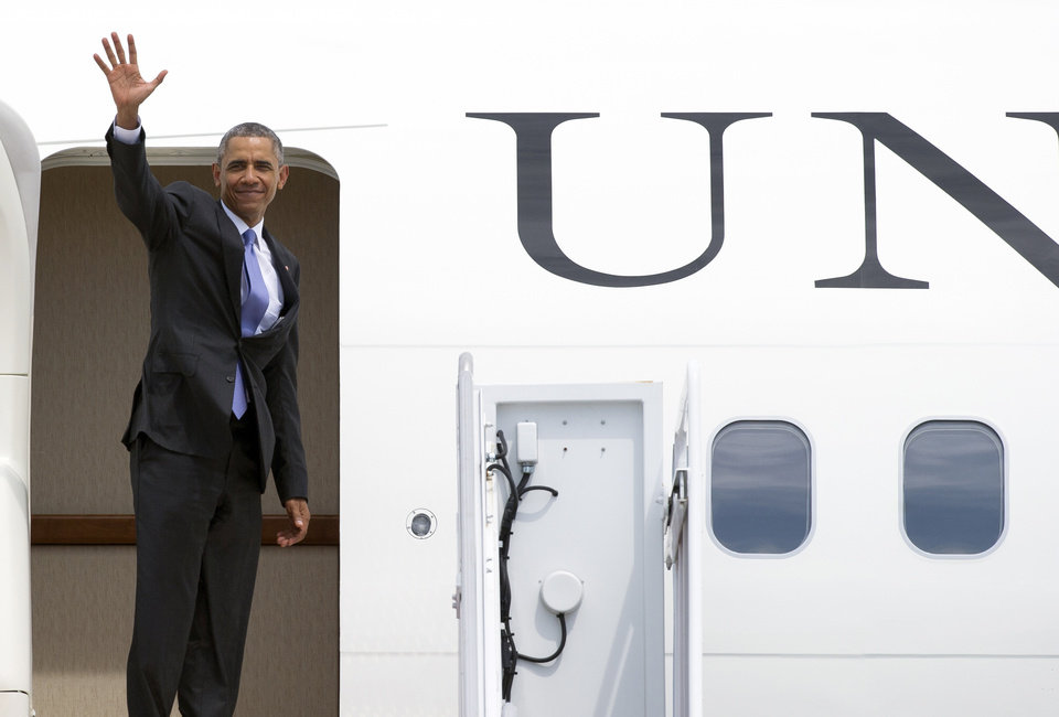 Photo - President Barack Obama waves as he boards Air Force One, Wednesday, July 15, 2015, at Andrews Air Force Base, Md. Obama is traveling to Durant, Okla., to speak in the Choctaw Nation on economic opportunities for underprivileged communities across the nation.  (AP Photo/Cliff Owen)