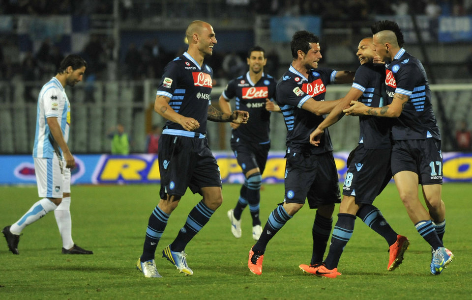 Photo - Napoli Swiss midfielder Gokhan Inler, second right, celebrates with teammates after scoring during a Serie A soccer match between Pescara and Napoli, at the Adriatico stadium in Pescara, Italy, Saturday, April 27, 2013. (AP Photo/Sandro Perozzi)