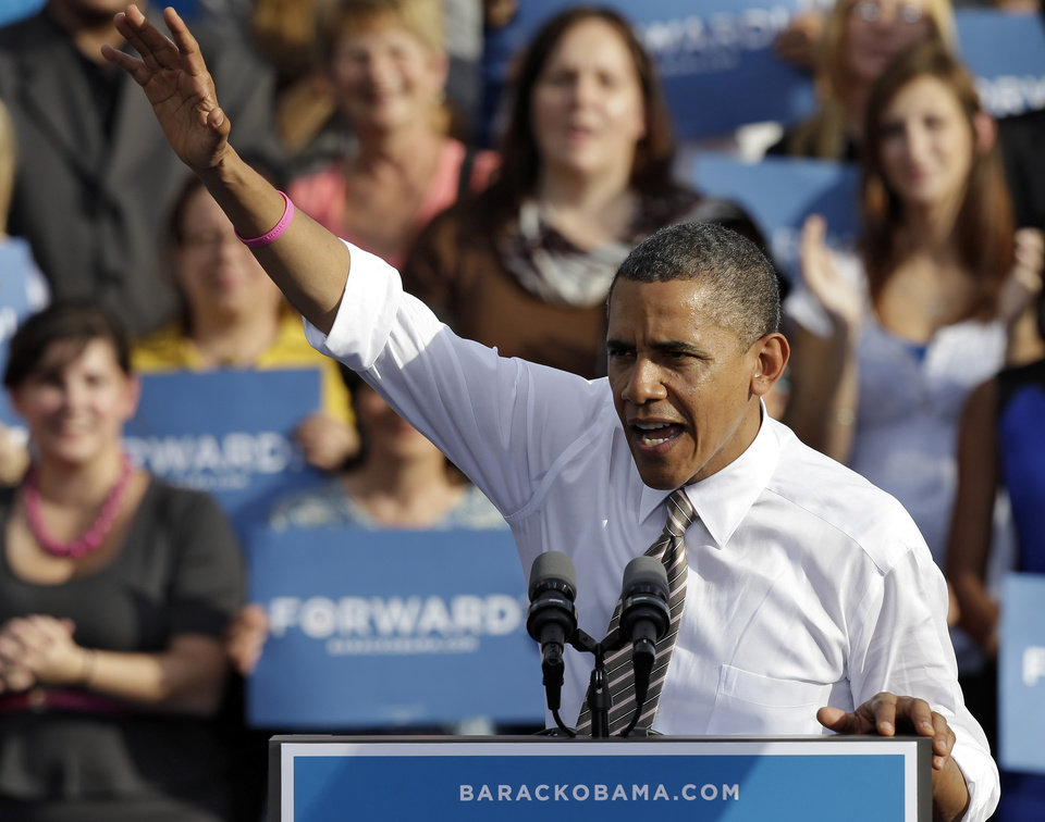 Photo -   President Obama waves to supporters while speaking at a campaign event at Ybor Centennial Park in Tampa, Fla., Thursday, Oct. 25, 2012. The president is on the second day of his 48 hour, 8 state campaign blitz. (AP Photo/Chris O'Meara)