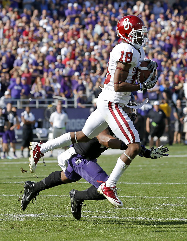 Oklahoma\'s Jalen Saunders (18) catches a touchdown pass in front of TCU\'s Sam Carter (17) during a college football game between the University of Oklahoma Sooners (OU) and the Texas Christian University Horned Frogs (TCU) at Amon G. Carter Stadium in Fort Worth, Texas, Saturday, Dec. 1, 2012. Photo by Bryan Terry, The Oklahoman