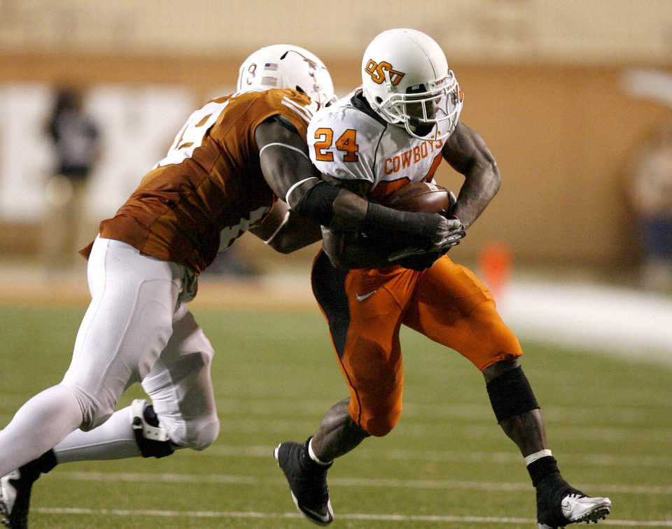 Photo - Texas' Emmanuel Acho (18) tackles Oklahoma State's Kendall Hunter (24)during the college football game between the Oklahoma State University Cowboys (OSU) and the University of Texas Longhorns (UT) at Darrell K Royal-Texas Memorial Stadium in Austin, Texas, Saturday, November 13, 2010. Photo by Sarah Phipps, The Oklahoman
