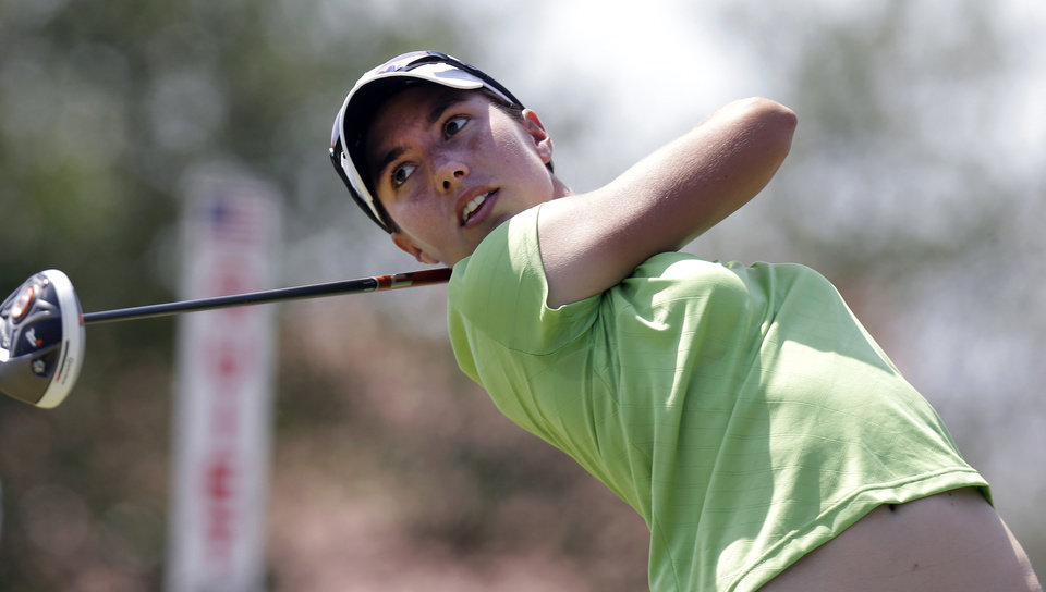 Carlota Ciganda, of Spain, watches her tee shot on the tenth hole during the final round of the North Texas LPGA Shootout golf tournament, Sunday, April 28, 2013, at Los Colinas Country Club in Irving, Texas. (AP Photo/LM Otero)