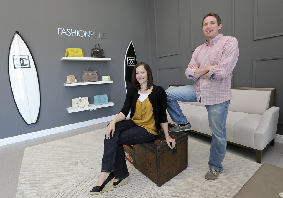 Photo - This photo taken May 2, 2013, shows Sarah Davis and Ben Hemmnger, co-owners of Fashionphile.com posing in the lobby of their Carlsbad, Calif. office.  The internet company sells rare, vintage, and discontinued previous owned bags and is facing the complicated task of dealing with new state regulations on Internet sale taxes. (AP photo/Lenny Ignelzi)