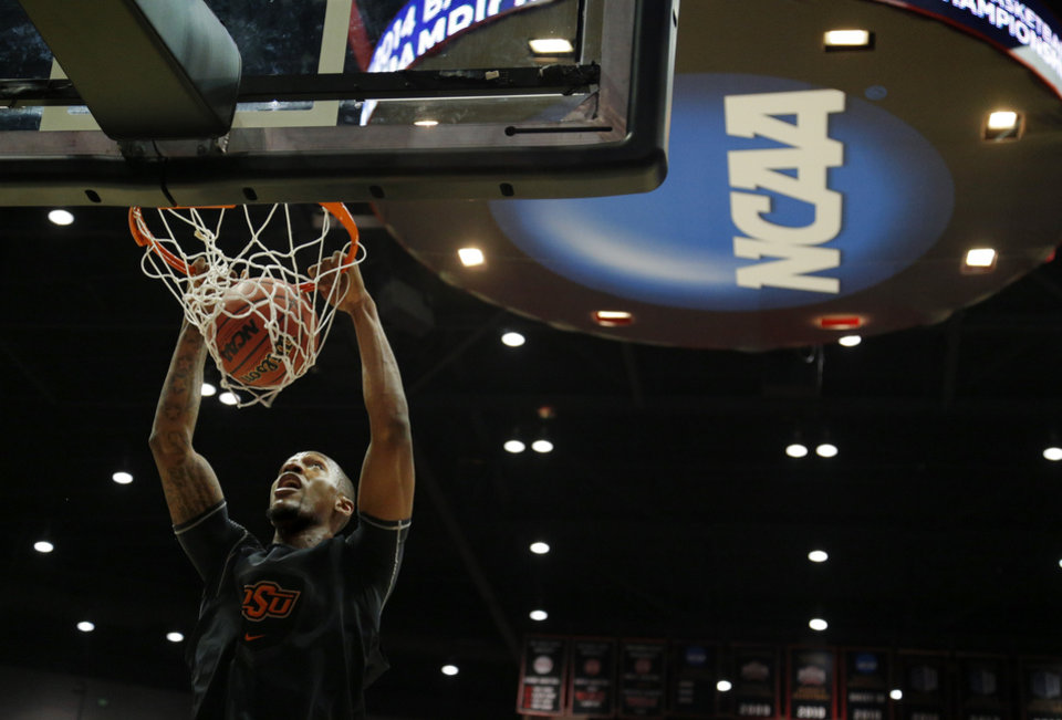 Photo - OSU's Kamari Murphy dunks the ball during a practice the day before Oklahoma State's second round game of the NCAA men's college basketball tournament at Viejas Arena in San Diago, Thursday, March 20, 2014. Oklahoma State will face Gonzaga in their NCAA Tournament game on Friday, March 21, 2104. Photo by Bryan Terry, The Oklahoman